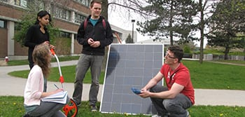 Students working with a solar panel